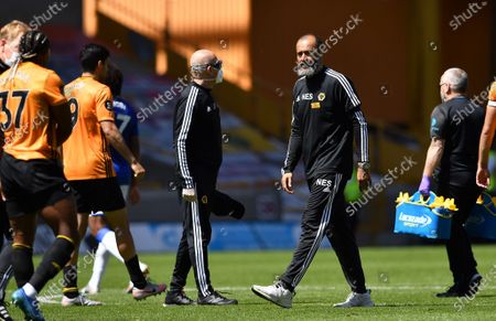 Wolverhampton Wanderers manager Nuno Espirito Santo (2-R) reacts after the English Premier League soccer match between Wolverhampton Wanderers and Everton FC in Wolverhampton, Britain, 12 July 2020.