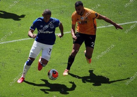 Everton's Richarlison (L) in action against Romain Saiss (R) of Wolverhampton during the English Premier League soccer match between Wolverhampton Wanderers and Everton FC in Wolverhampton, Britain, 12 July 2020.