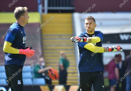Crystal Palace goalkeepers Wayne Hennessey (L) and Vicente Guaita (R) warm up ahead of the English Premier League soccer match between Aston Villa and Crystal Palace in Birmingham, Britain, 12 July 2020.