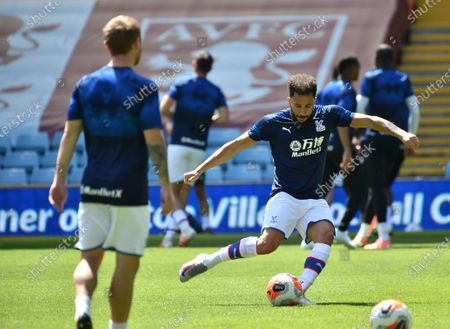 Andros Townsend (R) of Crystal Palace warms up ahead of the English Premier League soccer match between Aston Villa and Crystal Palace in Birmingham, Britain, 12 July 2020.