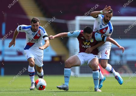 John McGinn (C) of Aston Villa in action against Luka Milivojevic (R) of Crystal Palace during the English Premier League soccer match between Aston Villa and Crystal Palace in Birmingham, Britain, 12 July 2020.