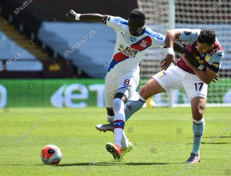 Trezeguet (R) of Aston Villa in action against Cheikhou Kouyate (L) of Crystal Palace during the English Premier League soccer match between Aston Villa and Crystal Palace in Birmingham, Britain, 12 July 2020.