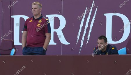 Aston Villa's manager Dean Smith (L) and assistant manager John Terry (R) react in the stands during the English Premier League soccer match between Aston Villa and Crystal Palace in Birmingham, Britain, 12 July 2020.