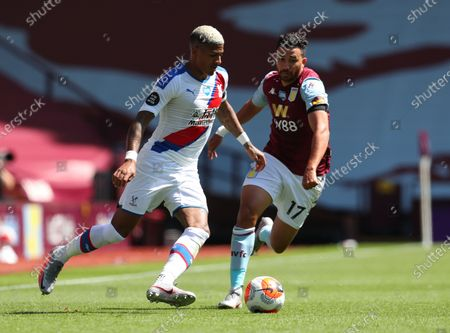 Trezeguet (R) of Aston Villa in action against  Patrick van Aanhalt (L) of Crystal Palace during the English Premier League soccer match between Aston Villa and Crystal Palace in Birmingham, Britain, 12 July 2020.