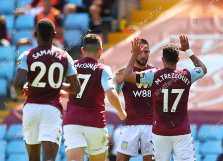 Trezeguet (R) of Aston Villa celebrates with teammates after scoring the 1-0 lead during the English Premier League soccer match between Aston Villa and Crystal Palace in Birmingham, Britain, 12 July 2020.