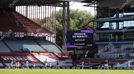 A video assistant referee (VAR) decision is announced on a huge screen during the English Premier League soccer match between Aston Villa and Crystal Palace in Birmingham, Britain, 12 July 2020.