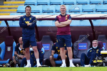 Aston Villa's manager Dean Smith (R) and assistant manager John Terry (L) react during the English Premier League soccer match between Aston Villa and Crystal Palace in Birmingham, Britain, 12 July 2020.