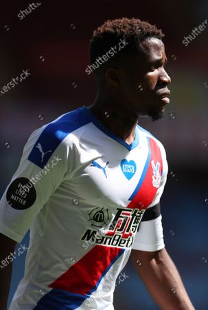 Wilfried Zaha of Crystal Palace reacts during the English Premier League soccer match between Aston Villa and Crystal Palace in Birmingham, Britain, 12 July 2020.
