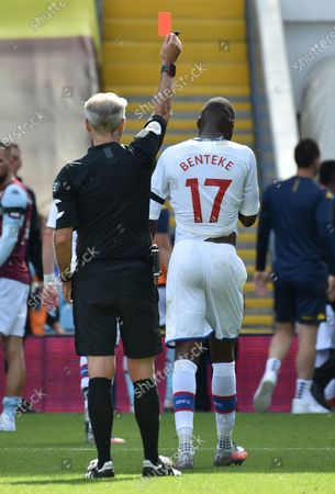 Christian Benteke (R) of Crystal Palace is sent off by referee Martin Atkinson (L) during the English Premier League soccer match between Aston Villa and Crystal Palace in Birmingham, Britain, 12 July 2020.