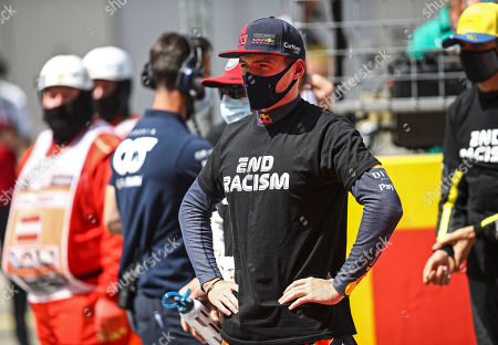 Red Bull driver Max Verstappen of the Netherlands stands against racism in the pit lane prior the Styrian Formula One Grand Prix race at the Red Bull Ring racetrack in Spielberg, Austria, Sunday, July 12, 2020. (Mark Thompson/Pool via AP)