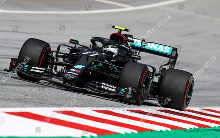 Mercedes driver Valtteri Bottas of Finland steers his car during the Styrian Formula One Grand Prix race at the Red Bull Ring racetrack in Spielberg, Austria, Sunday, July 12, 2020. (Mark Thompson/Pool via AP)
