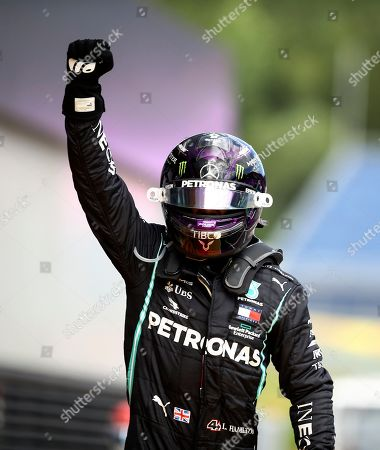 Mercedes driver Lewis Hamilton of Britain celebrates after winning the Styrian Formula One Grand Prix race at the Red Bull Ring racetrack in Spielberg, Austria, Sunday, July 12, 2020. (Mark Thompson/Pool via AP)