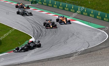 Mercedes driver Lewis Hamilton, left, of Britain, leads during the Styrian Formula One Grand Prix at the Red Bull Ring racetrack in Spielberg, Austria, Sunday, July 12, 2020. (Joe Klamar/Pool via AP)