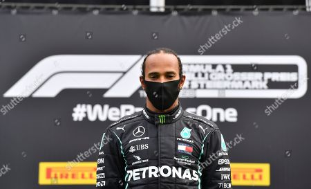 Mercedes driver Lewis Hamilton of Britain stands on the podium after winning the Styrian Formula One Grand Prix at the Red Bull Ring racetrack in Spielberg, Austria, Sunday, July 12, 2020. (Joe Klamar/Pool via AP)