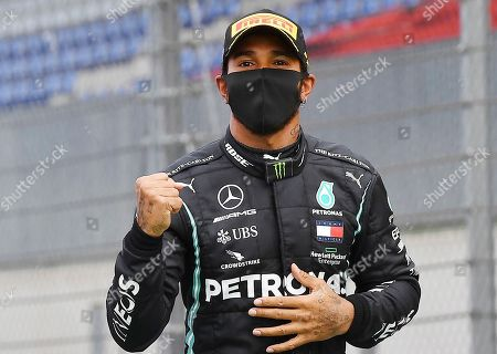 Mercedes driver Lewis Hamilton of Britain celebrates after winning the Styrian Formula One Grand Prix at the Red Bull Ring racetrack in Spielberg, Austria, Sunday, July 12, 2020. (Joe Klamar/Pool via AP)