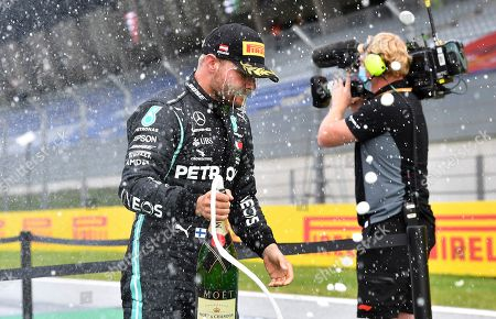 Mercedes driver Valtteri Bottas of Finland celebrates after taking second place during the Styrian Formula One Grand Prix at the Red Bull Ring racetrack in Spielberg, Austria, Sunday, July 12, 2020. (Joe Klamar/Pool via AP)