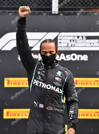 Mercedes driver Lewis Hamilton of Britain celebrates on the podium after winning the Styrian Formula One Grand Prix at the Red Bull Ring racetrack in Spielberg, Austria, Sunday, July 12, 2020. (Joe Klamar/Pool via AP)