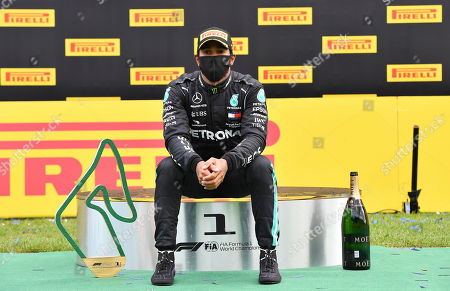 Mercedes driver Lewis Hamilton of Britain sits on the podium after winning the Styrian Formula One Grand Prix at the Red Bull Ring racetrack in Spielberg, Austria, Sunday, July 12, 2020. (Joe Klamar/Pool via AP)