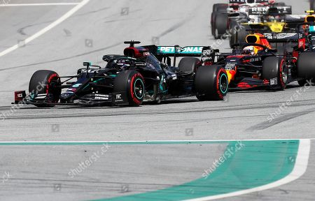 Mercedes driver Lewis Hamilton, left, of Britain, leads during the Styrian Formula One Grand Prix at the Red Bull Ring racetrack in Spielberg, Austria, Sunday, July 12, 2020. (AP Photo/Darko Bandic, Pool)