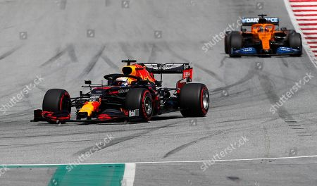 Red Bull driver Max Verstappen, left, of the Netherlands, steers his car as he followed by Mclaren driver Carlos Sainz of Spain during the Styrian Formula One Grand Prix at the Red Bull Ring racetrack in Spielberg, Austria, Sunday, July 12, 2020. (AP Photo/Darko Bandic, Pool)