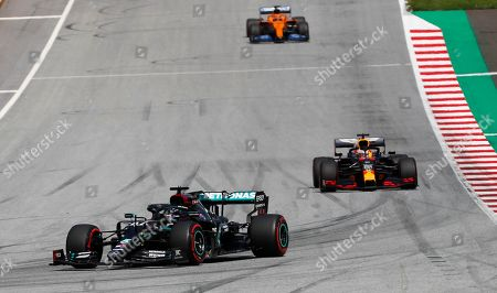 Mercedes driver Lewis Hamilton, left, of Britain, leads as he followed by Red Bull driver Max Verstappen of the Netherlands and Mclaren driver Carlos Sainz, top, of Spain, during the Styrian Formula One Grand Prix at the Red Bull Ring racetrack in Spielberg, Austria, Sunday, July 12, 2020. (AP Photo/Darko Bandic, Pool)