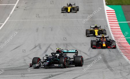 Mercedes driver Valtteri Bottas, left, of Finland, steers his car during the Styrian Formula One Grand Prix at the Red Bull Ring racetrack in Spielberg, Austria, Sunday, July 12, 2020. (AP Photo/Darko Bandic, Pool)