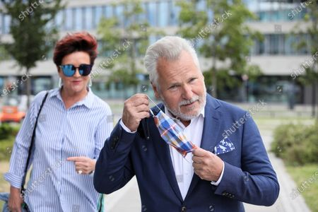 Former president of Poland Aleksander Kwasniewski (R) with his wife Jolanta (L) casts his ballot at a polling station during presidential elections, in Warsaw, Poland, 12 July 2020.