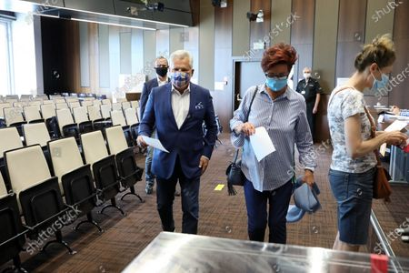Former president of Poland Aleksander Kwasniewski (C-L) with his wife Jolanta (C-R) casts his ballot at a polling station during presidential elections, in Warsaw, Poland, 12 July 2020.