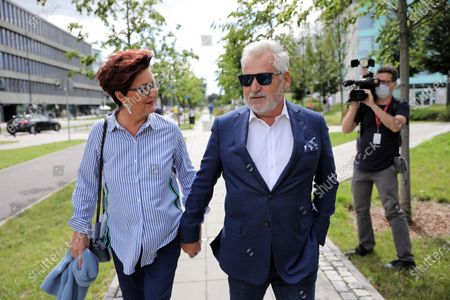 Stock Image of Former president of Poland Aleksander Kwasniewski (R) with his wife Jolanta (L) casts his ballot at a polling station during presidential elections, in Warsaw, Poland, 12 July 2020.