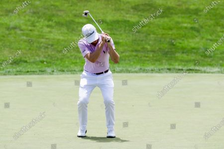 Justin Thomas reacts after missing a putt on the 18th hole during the final round of the Workday Charity Open golf tournament, in Dublin, Ohio