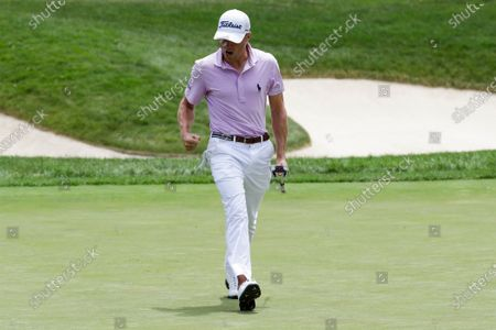 Justin Thomas reacts to a putt on the first playoff hole during the final round of the Workday Charity Open golf tournament, in Dublin, Ohio