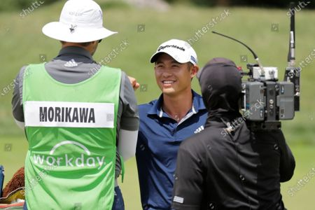 Collin Morikawa smiles after winning the Workday Charity Open golf tournament on the third playoff hole, in Dublin, Ohio