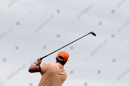 Rickie Fowler hits on the fifth hole during the final round of the Workday Charity Open golf tournament, in Dublin, Ohio