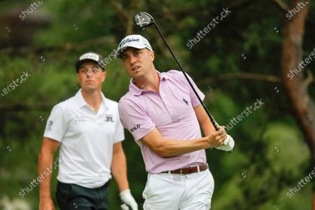 Justin Thomas hits on the second hole during the final round of the Workday Charity Open golf tournament, in Dublin, Ohio