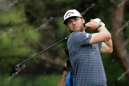 Sam Burns hits on the second hole during the final round of the Workday Charity Open golf tournament, in Dublin, Ohio