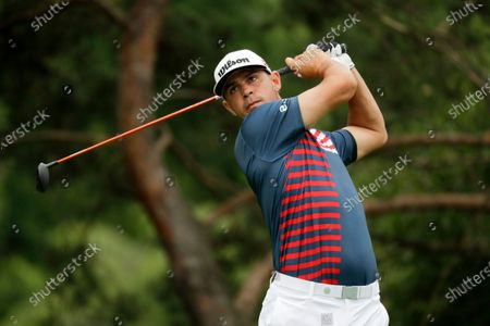 Gary Woodland hits on the second hole during the final round of the Workday Charity Open golf tournament, in Dublin, Ohio