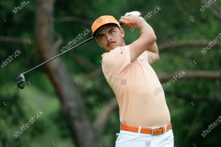 Rickie Fowler hits on the second hole during the final round of the Workday Charity Open golf tournament, in Dublin, Ohio