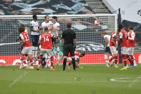 Pierre-Emerick Aubameyang of Arsenal curls a free kick at the Spurs goal during the Tottenham Hotspur vs Arsenal Premier League Football match at the Tottenham Hotspur Stadium on 12th July 2020