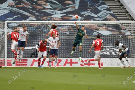 Emiliano Martinez of Arsenal clears a Spurs attack during the Tottenham Hotspur vs Arsenal Premier League Football match at the Tottenham Hotspur Stadium on 12th July 2020