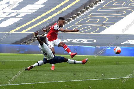 Pierre-Emerick Aubameyang of Arsenal blasts a shot that hit the woodwork during the Tottenham Hotspur vs Arsenal Premier League Football match at the Tottenham Hotspur Stadium on 12th July 2020