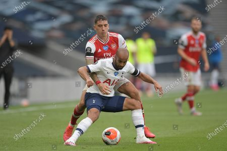 Lucas of Tottenham Hotspur clashes with Hector Bellerin of Arsenal during the Tottenham Hotspur vs Arsenal Premier League Football match at the Tottenham Hotspur Stadium on 12th July 2020