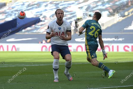 Harry Kane of Tottenham Hotspur is halted by Emiliano Martinez of Arsenal during the Tottenham Hotspur vs Arsenal Premier League Football match at the Tottenham Hotspur Stadium on 12th July 2020