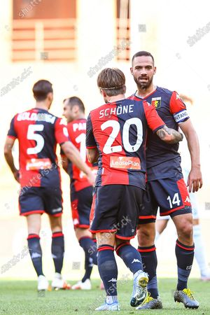 Genoa's Lasse Schone (2-R) celebrates with teammate Davide Biraschi (R) after scoring the 2-0 lead during the Italian Serie A soccer match between Genoa CFC and SPAL Ferrara at Luigi Ferraris stadium in Genoa, Italy, 12 July 2020.