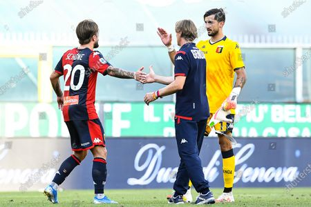 Genoa's head coach Davide Nicola (C) celebrates with Lasse Schone (L) and goalkeeper Mattia Perin (R) after the Italian Serie A soccer match between Genoa CFC and SPAL Ferrara at Luigi Ferraris stadium in Genoa, Italy, 12 July 2020.