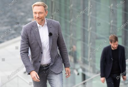 Leader of German Free Democratic Party Christian Lindner (L) attends the traditional summer interview of the television show 'Report from Berlin' of German station ARD, in Berlin, Germany, 12 July 2020.