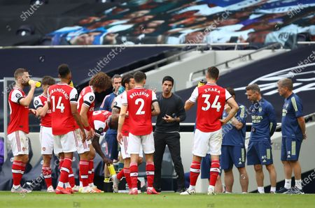 Arsenal's manager Mikel Arteta (C) gives instructions to his players during the English Premier League soccer match between Tottenham Hotspur and Arsenal FC in London, Britain, 12 July 2020.
