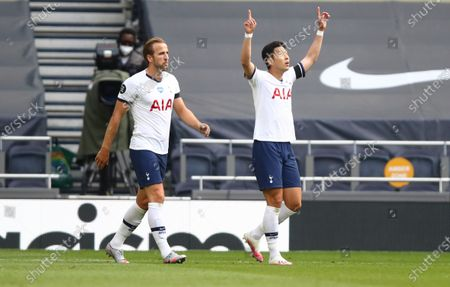 Son Heung-min (R) of Tottenham celebrates next to teammate Harry Kane (L) after scoring the 1-1 equalizer during the English Premier League soccer match between Tottenham Hotspur and Arsenal FC in London, Britain, 12 July 2020.