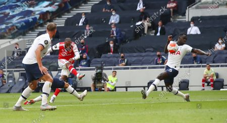 Alexandre Lacazette (C) of Arsenal scores the opening goal during the English Premier League soccer match between Tottenham Hotspur and Arsenal FC in London, Britain, 12 July 2020.