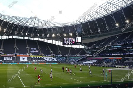 Players in action in front of empty stands during the English Premier League soccer match between Tottenham Hotspur and Arsenal FC in London, Britain, 12 July 2020.