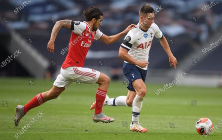 Giovani Lo Celso (R) of Tottenham in action against Dani Ceballos (L) of Arsenal during the English Premier League soccer match between Tottenham Hotspur and Arsenal FC in London, Britain, 12 July 2020.